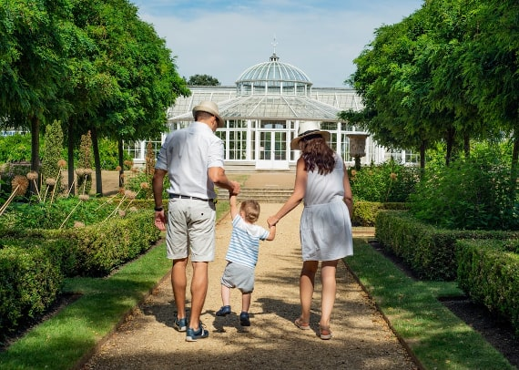 A family walking in a garden